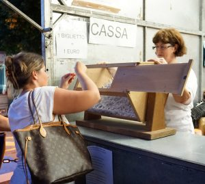 Lady picking a ticket at the pesca