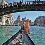 On a gondola under Accademia bridge